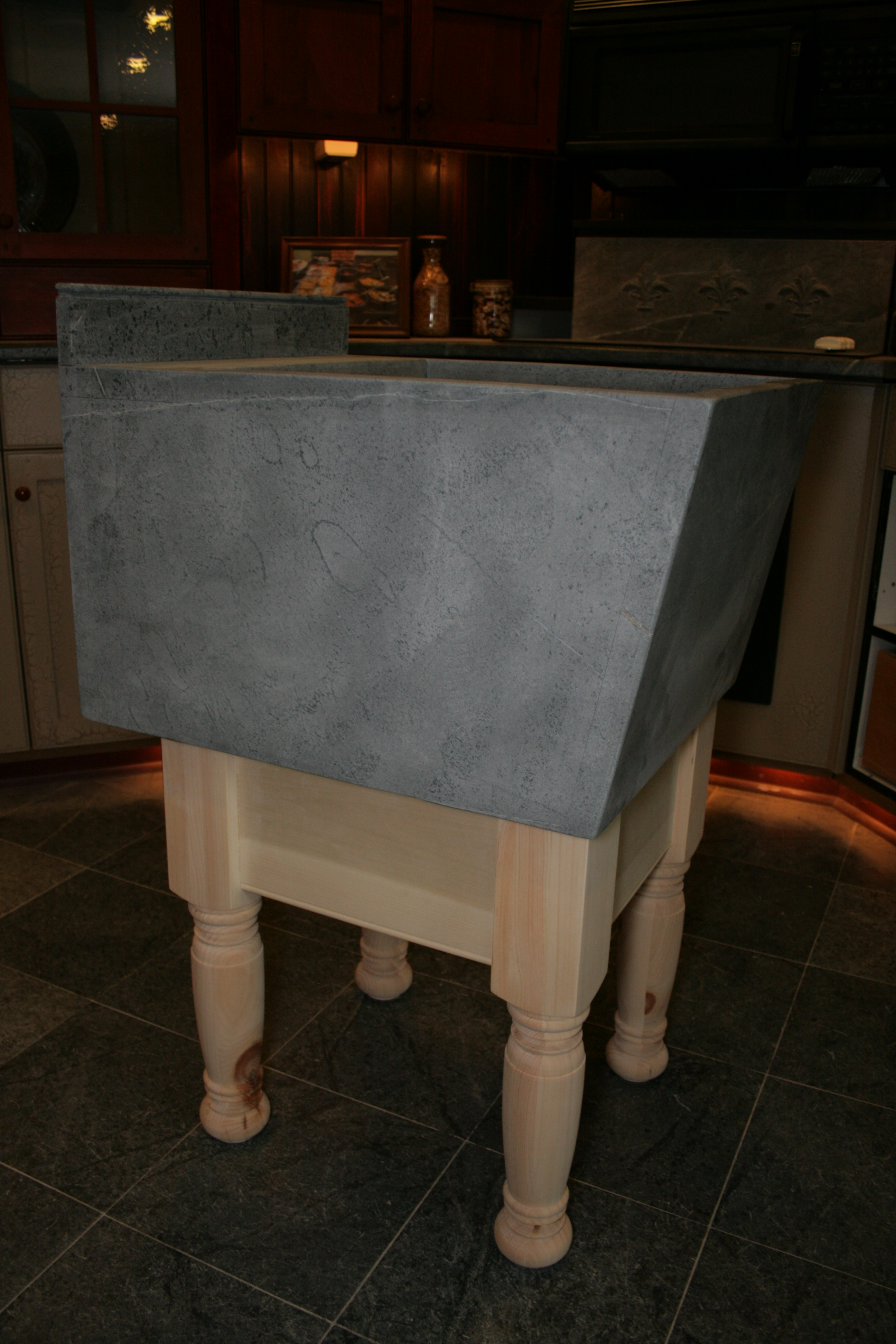 Soapstone Laundry Sink : Laundry sink with base - side view