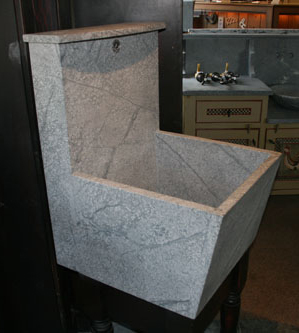 high backsplash laundry tub with washboard