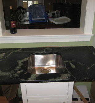 Comparison of a soapstone vegetable sink and a stainless steel sink.