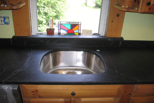 Comparison of a Soapstone sink with a stainless steel