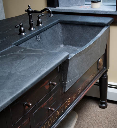Franklin island sink with slant front and bow.