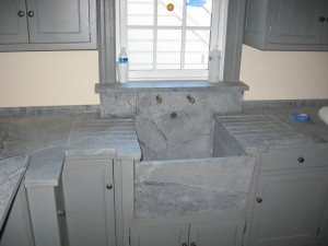 High backsplash sink with side wings, recessed drainboards slant front