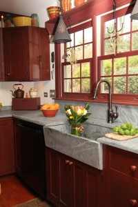 Soapstone sink and countertops on red cabinets