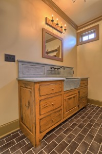 Vanity with high backsplash and soapstone sink